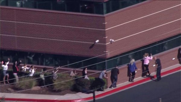 20-30 hostages released from Nextep building standoff in Norman, Oklahoma. Possible armed man
