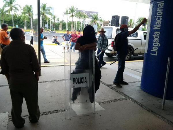 Mexico: Protesters adding some new graffiti at the Acapulco airport