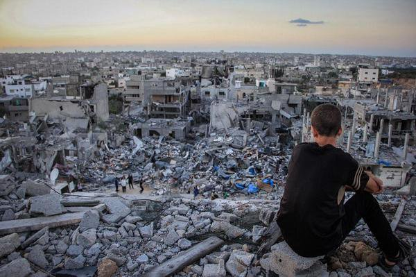 Powerful image of a Palestinian child looking over destruction in Gaza.