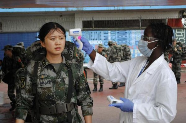 China, criticised for its response to Ebola, sends 160 workers to Liberia to staff $41m clinic