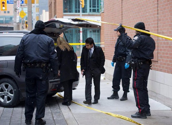 One dead, two injured in a triple shooting in a downtown restaurant in Toronto.