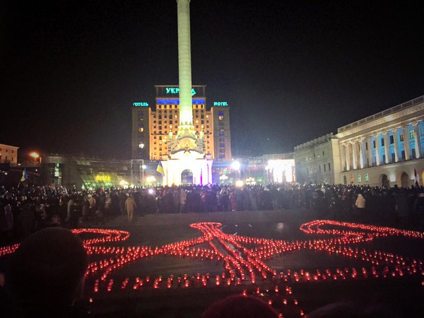 A huge coat of arms of the ever-burning fires at the Maidan