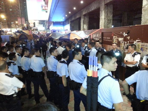 Large number of police form cordon around pro-Beijing group