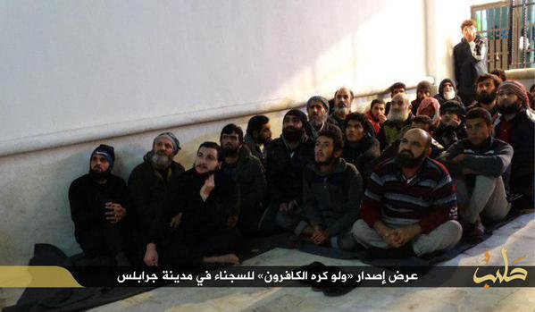 Prisoners of ISIS in Jarablus, Syria near Turkey. Appears they are being forced to watch IS propaganda.