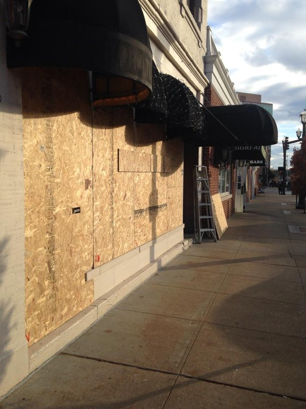Some, but not all, businesses boarded up in Clayton