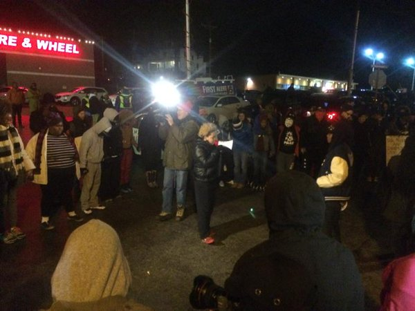 Outside Ferguson PD protesters pray