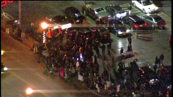 Crowd grows to about 100 at Ferguson police department