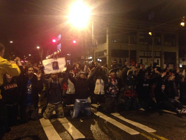 Ferguson protesters in Seattle are kneeling now. Everyone has linked arms.