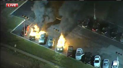 A Dellwood car lot and gas station ablaze right now.  Ferguson unrest continues into early morning hours.