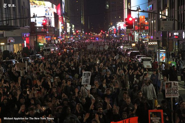 Protesters marched on Seventh Avenue in NYC following the grand jury decision in Ferguson on Monday.