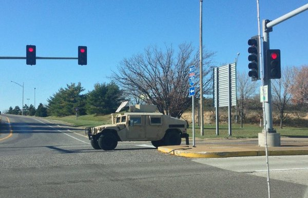 Several military vehicles spotted close to St Louis Airport right now. Ferguson FergusonDecision