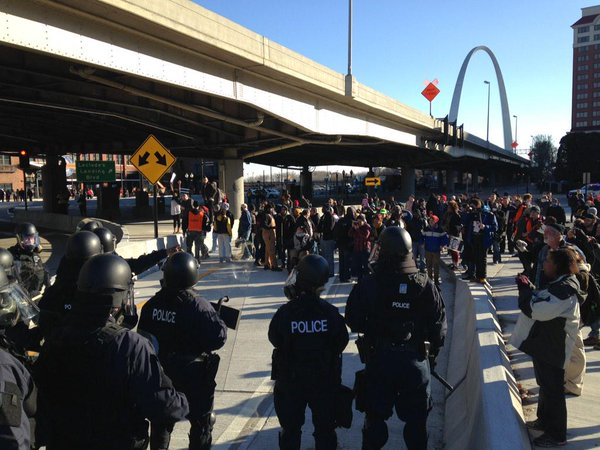 Police in riot gear forcing protestors off the 70 with pepper spray. Several arrest. shutitdown Fergsuon STL