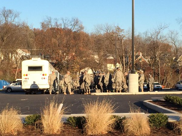 Two bus loads of National Guard troops in full riot gear just arriving outside Ferguson police department