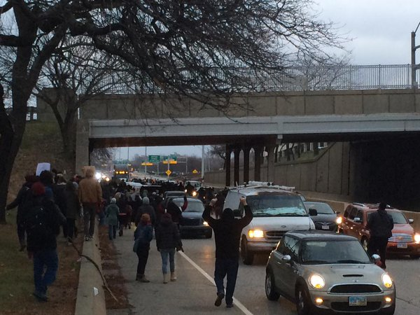 Cleveland Hands up don't shoot! Marching on highway NOW FergusonDecision