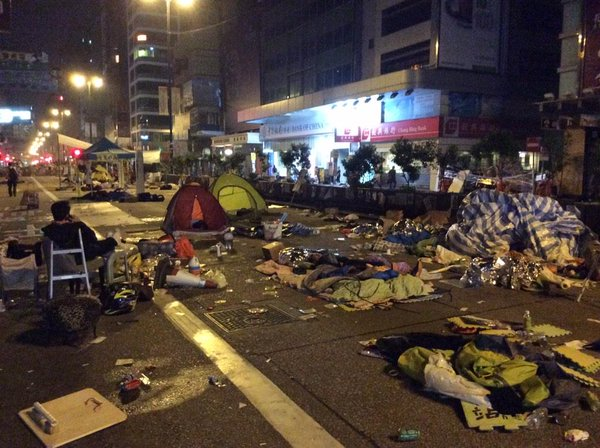 The entire road looks like a battlefield. Glad it's both warm and dry for the sleeping protestors. OccupyHK