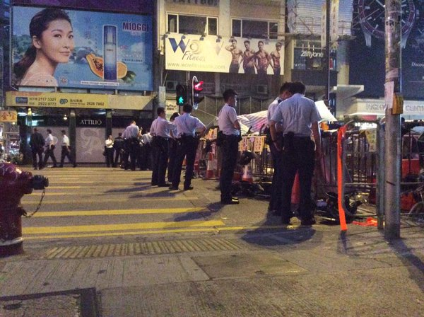 Police at Dundas St. barrier. Helmets and flags at rest, the events of the night feel a hundred years away. OccupyHK