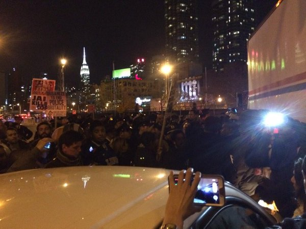 Standoff at Lincoln Tunnel entrance- police won't let protesters pass, traffic stalled. Pushing, shoving