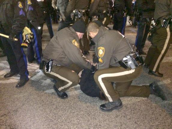 Two arrested in front of Ferguson PD. About 50 Guardsmen backing up STL Co. Police.