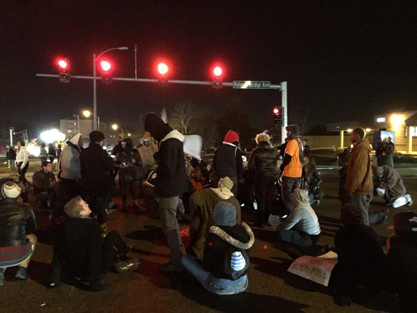 Protestors staging a non-violent sit-in at the intersection of Natural Bridge & Kingshighway