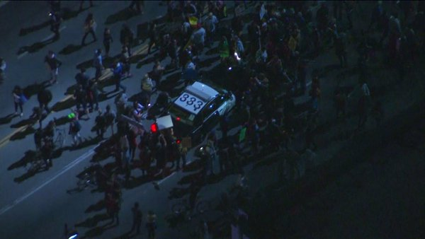 Protesters have surround @CHPsouthern patrol car  Ferguson