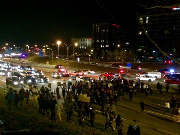 Protestors shutting down I95 in providence ferguson