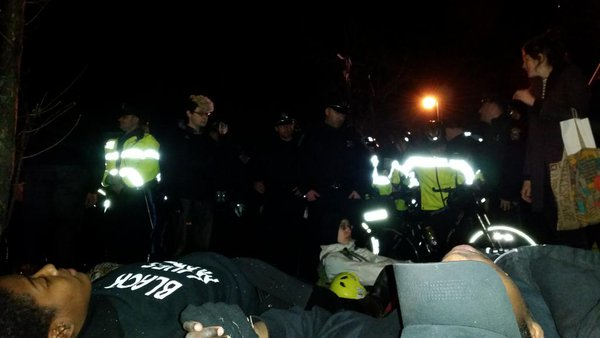 6 protesters now laying on front of cops. Ignoring requests to disperse. Boston Ferguson
