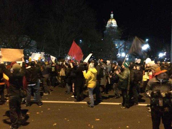 Protestors march in Denver - block traffic on Broadway over Ferguson grand jury decision