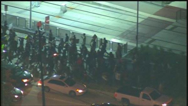Ferguson protesters turned off Wheeler onto Cullen & are marching thru the University of Houston campus