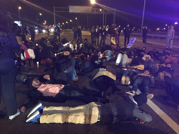 Protestors lying on I-24 - traffic at standstill in both directions near Shelby Ave in Nashville Ferguson