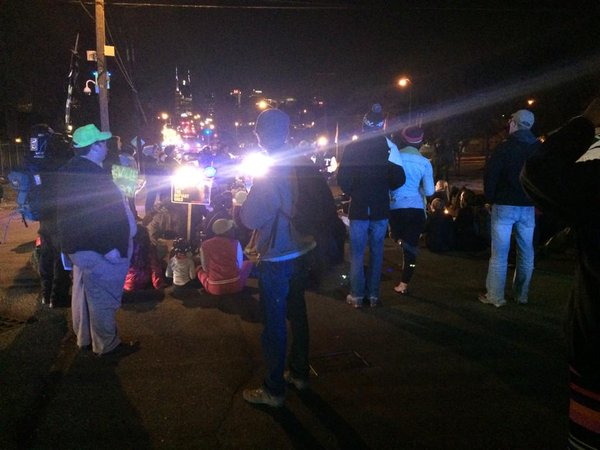 Ferguson demonstrators sitting down stopping traffic on Shelby Av, Nashville