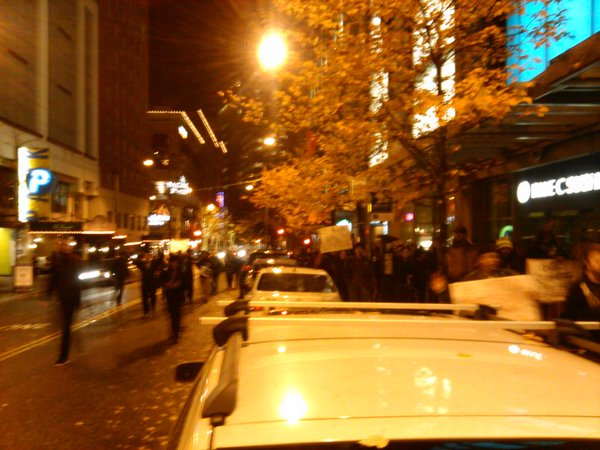 Main body of protesters stay on sidewalk, but more going onto street. Seattle Ferguson