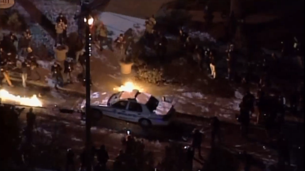 Ferguson police car torched.