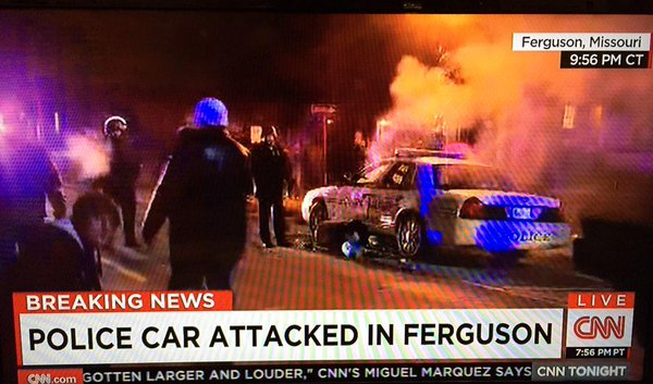 Another police cruiser torched in Ferguson.