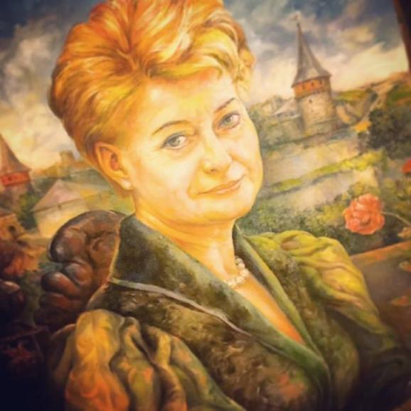 Grybauskaite showed her portrait, which was presented hеr by the Ukrainian soldier