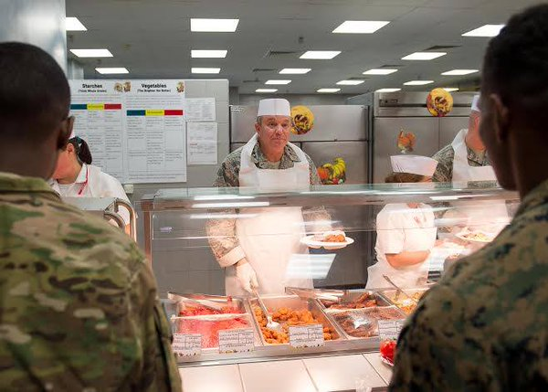 Thanksgiving in Romania -  General @PMBreedlove, serving traditional Thanksgiving dinner to US service members