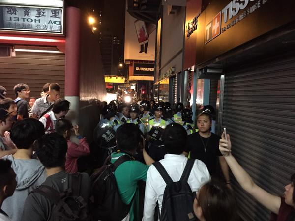 Police with riot shields gather by MTR exit