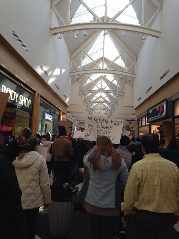 Protesters marching down St. Louis Galleria mall