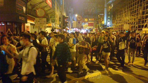 Protestor yell Bye at police cordon