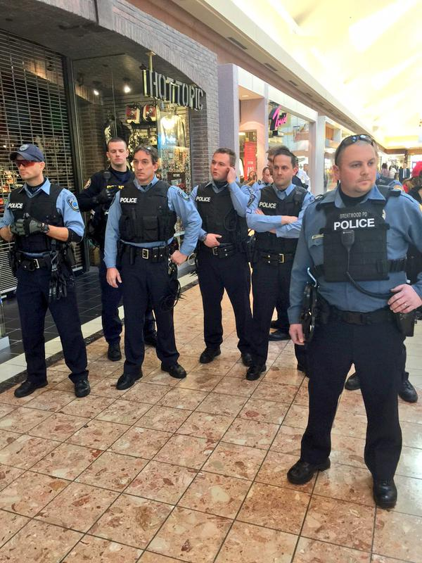 On the 3rd floor of St.Louis Galleria, the officers have congregate
