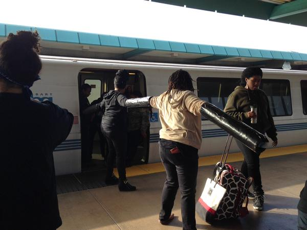 BlackoutBlackFriday activists lock down to stop BART train at West Oakland stop