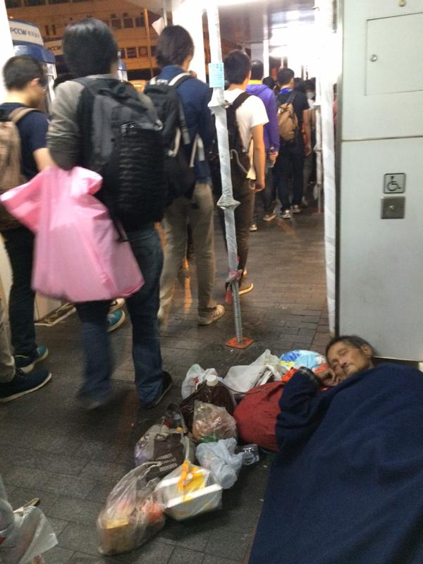 Protesters quiet each down as they see homeless person sleeping soundly OccupyHK