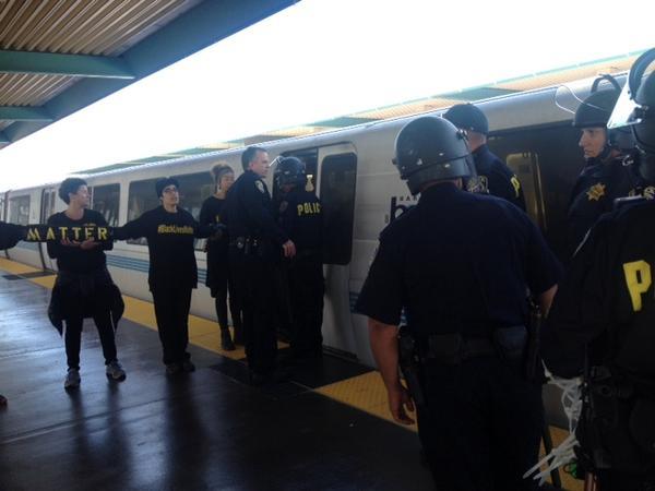 Police arrive at BART where Ferguson protest decision shut down Transbay service