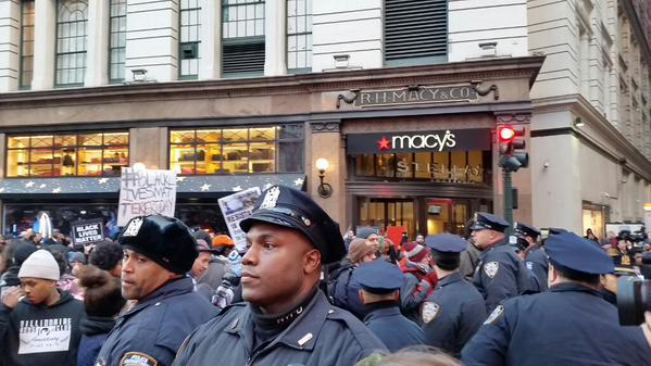 The police have formed a blue wall at 35th and Broadway