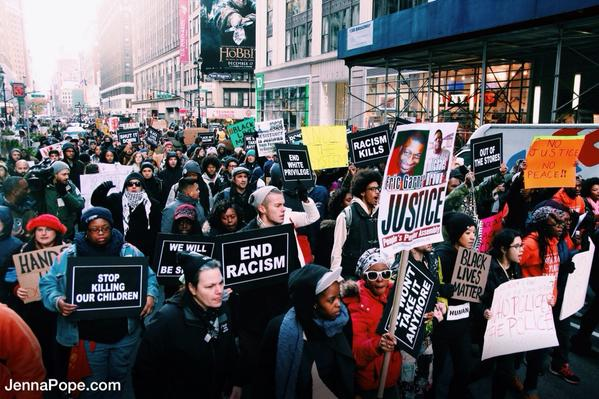 BlackoutBlackFriday Marching up broadway ave in NYC