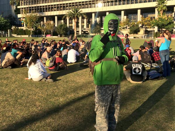 Protestors gathering in Grand Park, telling arrest stories and going over tactics