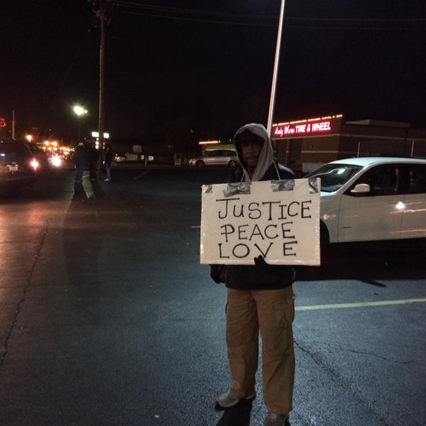 Lone protester outside Ferguson Police Department asks: Where is everybody tonight?