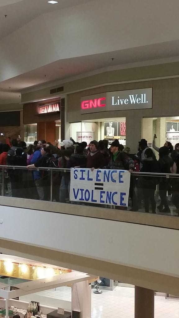 About 100 protesters marching & chanting in Chesterfield Mall. Police here too. No incidents