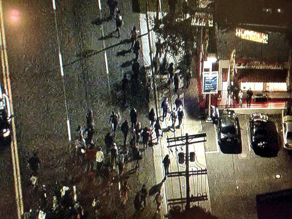 Ferguson protesters running away from LAPD. No longer in formation.