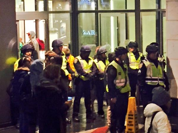 Seattle PD in riot gear are guarding the entrance to Westlake center. Protesters disrupted Christmas tree lighting.