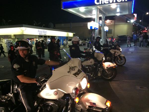 Cops revving bikes and forcing new group of protestors back. Ferguson